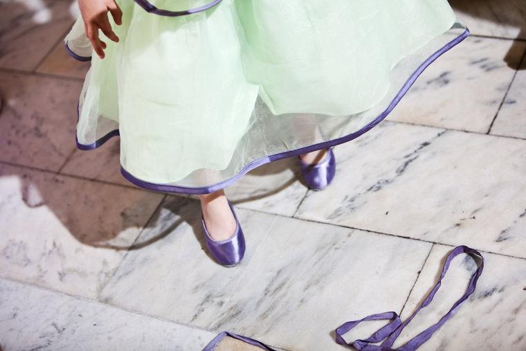 cmac wedding photographer spring reception marble floor purple shoes
